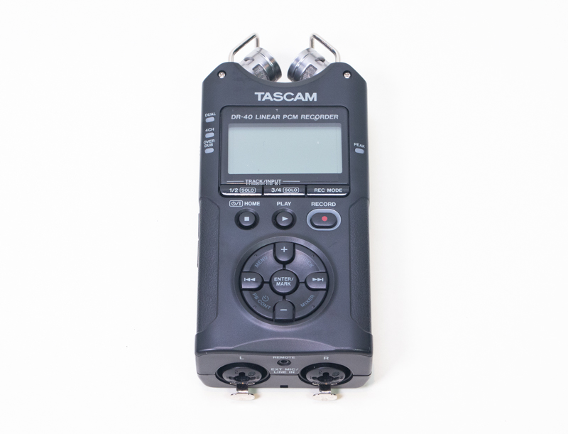 A black Tascam recorder
