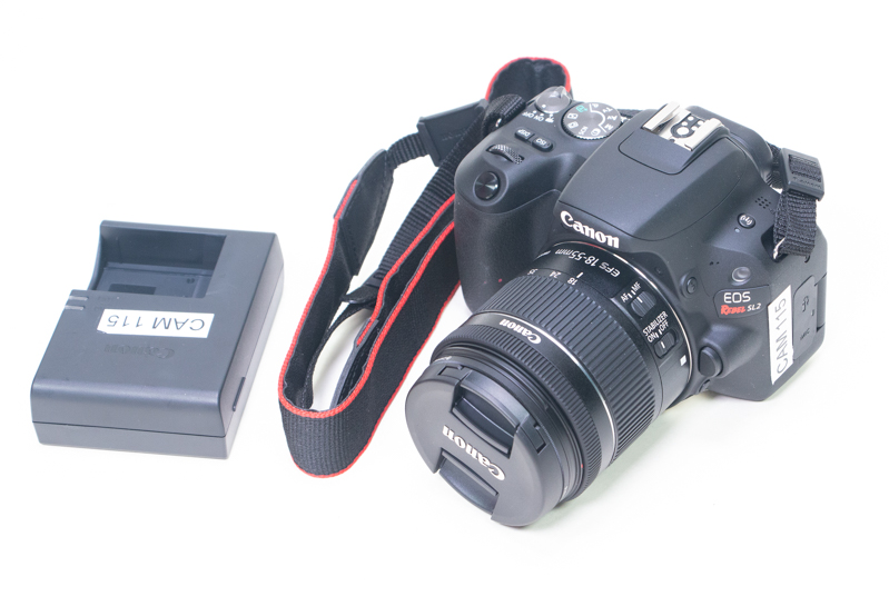 A Canon EOS Rebel SL2 with battery charger