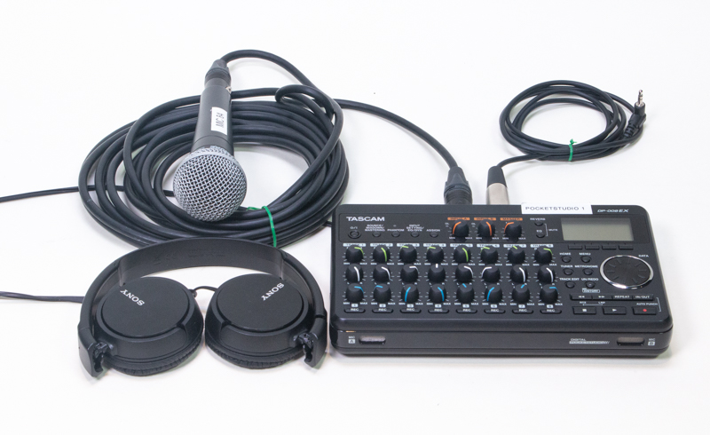 A pocketstudio, a microphone, headphones, and wires