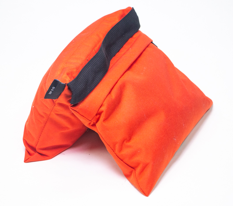 An orange saddle sandbag