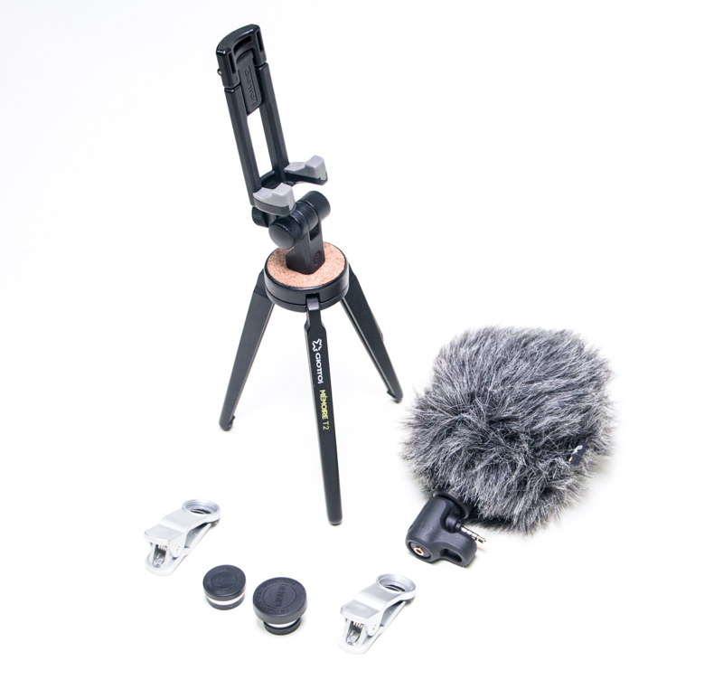 a Giottos Memoire T2 mini tripod, two clamps, two lenses, and a  microphone